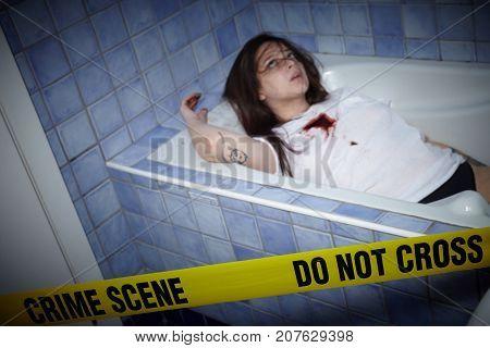 young woman lying dead in a bath tub