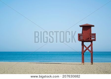 Red Wooden Lifeguard Tower On The Abandoned Beach At Benalmadena, Malaga Province, Spain. Beautiful