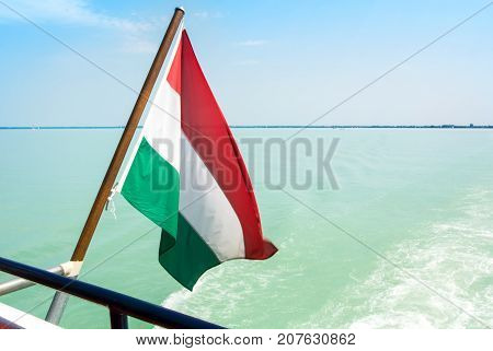 Hungarian Flag At The Cruise Ship With Bright Light Blue Water Of Balaton Lake At The Background Hun