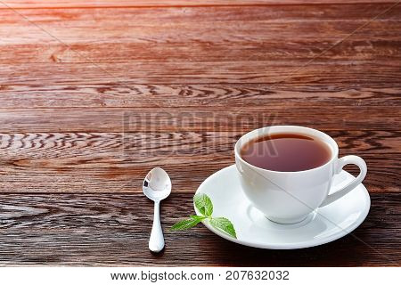 Hot earl grey tea with lemon slice top view on wood table background