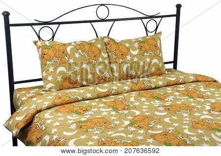 Double bed yellow with bears bed linens on a white background isolation