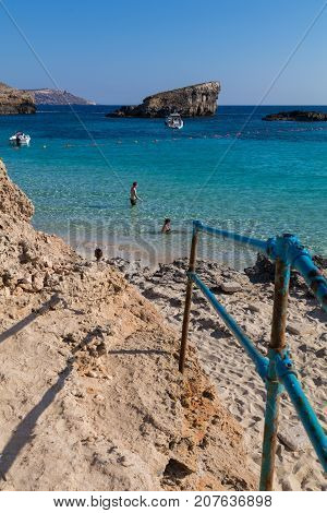 The stunningly beautiful holiday destination sandy beach of comino and crystal clear azure turquoise blue waters of the Blue Lagoon, island of Comino, Malta, June 2017