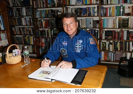 HUNTINGTON, NY - OCT 3: Commander Terry Virts signs his book