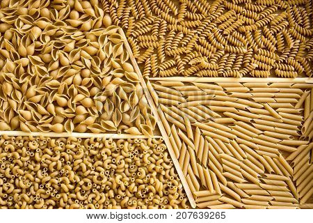 Assorted Whole Wheat Pasta On Wooden Tray