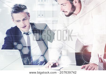 Two young company employees working in a white office. Graphs and infographics. Toned image double exposure