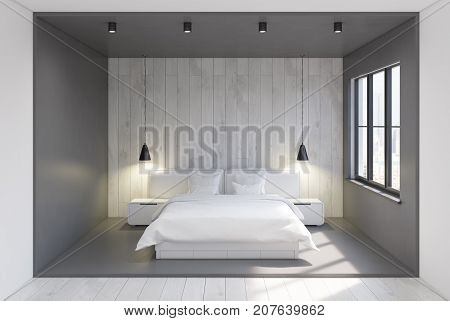 Front view of a modern bedroom interior with gray and woden walls a concrete and wooden floor and two bedside tables near a double bed. 3d rendering mock up
