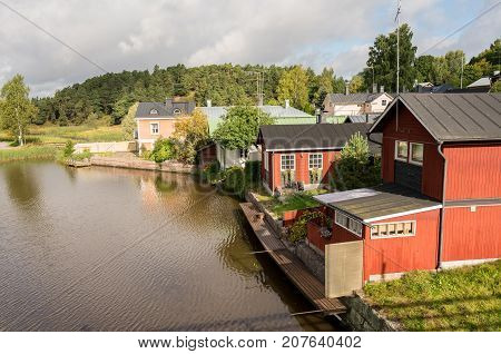 Red painted old wooden houses in the ancient town of Porvoo in Finland
