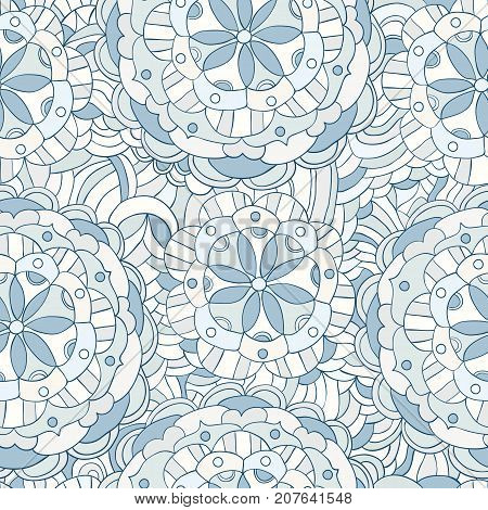Unique hand drawn vector pattern in pale blue colors with floral mandala motifs for textile and paper designs