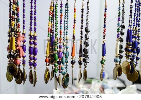 Tantra beads and pendants and chains on sale at a shop