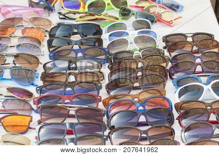 Sunglasses on sale at a shop in local fair