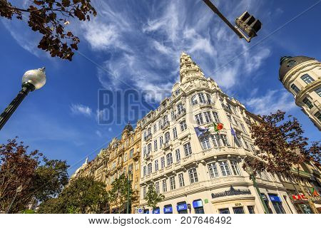Porto, Portugal - August 11, 2017: bottom view of historic facade of BBVA building bank in Avenida dos Aliados, Liberty square, the heart of Oporto city, in a sunny day with blue sky.