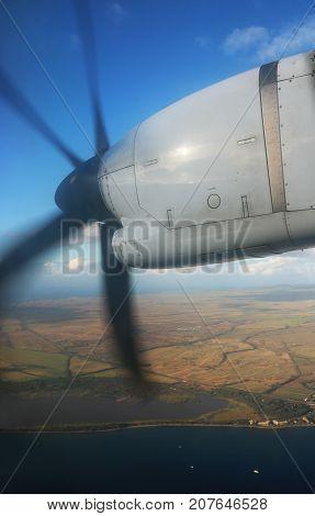 Turbo Prop in Flight over Island Coastline