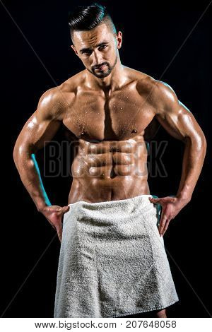 Wet Man After Shower With White Towel. Male Body With Drops Of Water Or Sweat. Man Closed His Penis