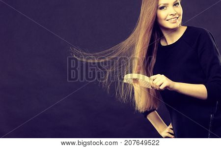 Long Haired Woman Combing Her Hair.