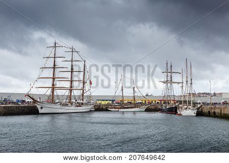Ancient sailboats moored in the port Sines, Portugal