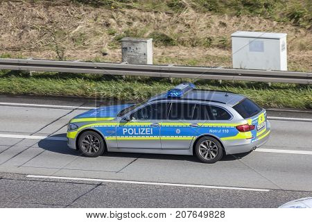 Frankfurt Germany - Sep 19 2017: BMW five series police car driving on the highway in Germany