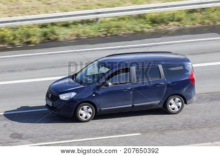 Frankfurt Germany - Sep 19 2017: Blue Dacia Lodgy family van driving on the highway in Germany