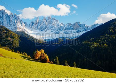 Magic image of sunny hills in Santa Magdalena village. Peaceful rural scene. Location famous place Funes valley, Odle Group, Dolomiti Alps. Bolzano province, South Tyrol, Italy. Europe. Beauty world.