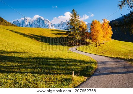 Magic image of alpine hills in Santa Magdalena village. Peaceful rural scene. Location famous place Funes valley, Odle Group, Dolomiti Alps. Bolzano province, South Tyrol, Italy. Europe. Beauty world