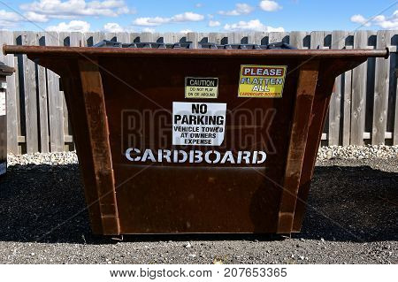 A dumpster earmarked for collecting cardboard at a solid transfer station