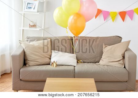 celebration and interior concept - sofa with cushions at cozy home room decorated for birthday party