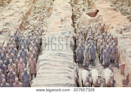 Xian July 2011 - In July many visitors come to see the terracotta army because it is included in the UNESCO World Heritage List. It is a symbolic army destined to serve the first Chinese Emperor Qin Shi Huang