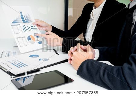Administrator business man financial inspector and secretary making report calculating balance. Internal Revenue Service checking document. Audit concept.