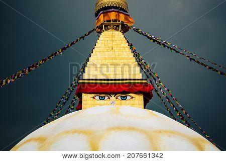 Boudhanath stupa in Kathmandu, Nepal. Stormy sky in the background.