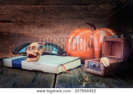 skull on book in Halloween day concept on old vintage wooden background. still life style with copy space add text ( full High definition Photo)