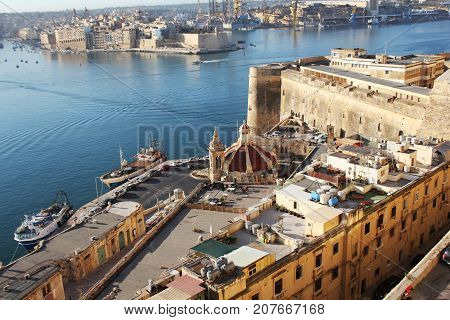 Panoramic skyline view of ancient defences of Valletta, Tree cities and the Grand Harbor , Malta .