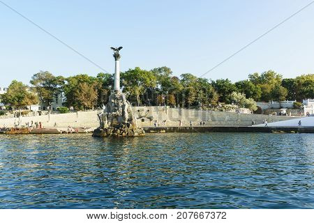 View From The Sea On The Promenade Of The City, Nakhimov Avenue And Monument To The Scuttled Ships