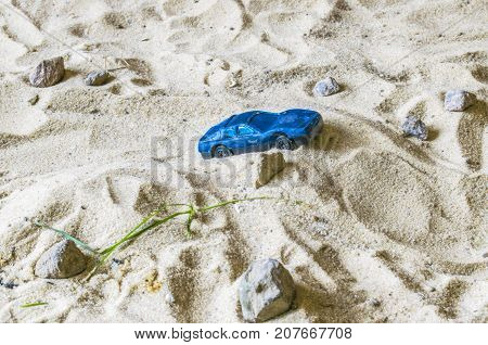 A Racing Car In The Sand Competes.