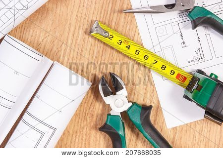 Rolls Of Electrical Drawings Or Diagrams And Work Tools For Engineer Jobs