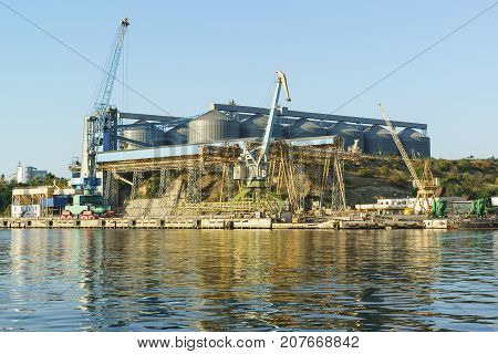 A View From The Bay To The Grain Terminal And Loading Cranes In Sea Port Mooring