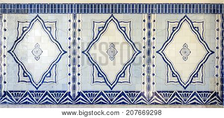 LISBON, PORTUGAL - September 25, 2017: Detail of Art Deco ceramic tiles decorating the walls of the Cais do Sodre Station in Lisbon Portugal