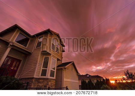 Sunset in North American suburbs neighborhood homes long exposure sky