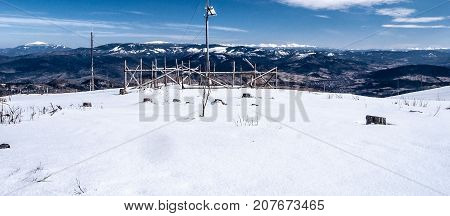 Babia Gora Pilsko Tatras mountain range Mala Fatra mountain range from Barania Gora hill in Silesian Beskids mountains in Poland during nice winter day with blue sky and only few clouds