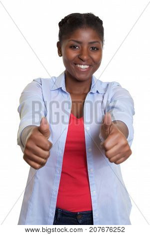 Laughing african woman showing both thumbs up on an isolated white background for cut out