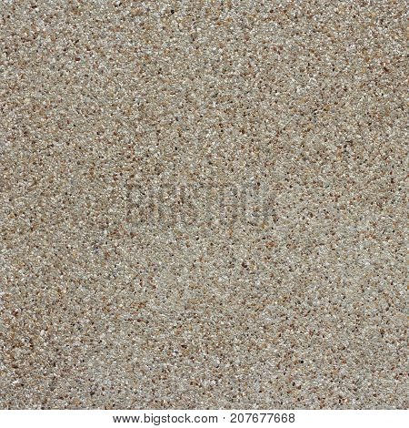 Small sand stone wall texture or sand wall background. Natural brown finishing for design