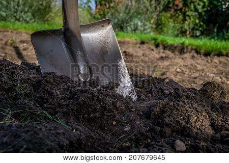 spade in the dirt in the garden gardenworking