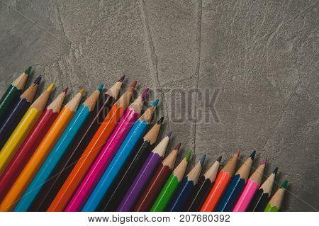 Colour pencils on grey concrete - background