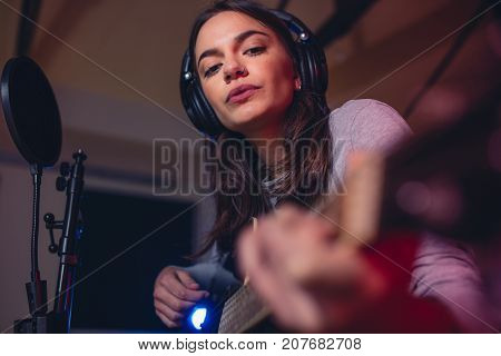 Guitarist Playing Guitar In A Recording Studio