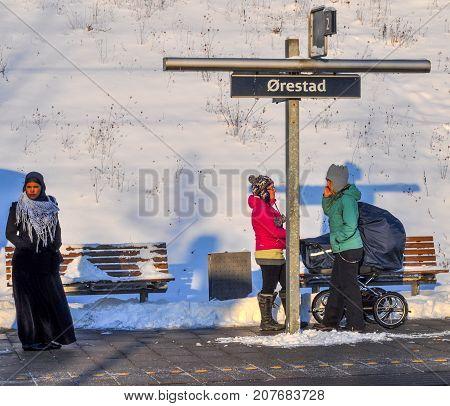 Copenhagen Denmark - Desember 22. 2017: People waiting for the train at Oerestad train station