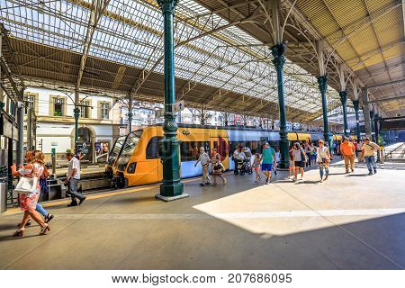 Porto, Portugal - August 13, 2017: train on platform of Sao Bento Railway Station, Oporto's main station. Tourists and locals use the station to move from one city to another in Portugal.