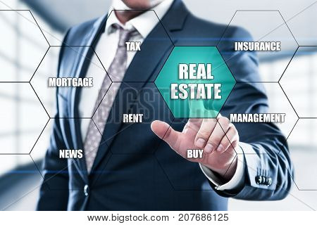Real Estate Mortgage Property Management Rent Buy concept on the hexagons and transparent honeycomb structure presentation screen. Man pressing button on display with word in modern office.