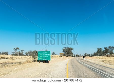 ASKHAM SOUTH AFRICA - JULY 6 2017: A directional sign on the R360-road from Tweerivieren in the Kgalagadi at the junction with the R31-road in the Northern Cape Province of South Africa