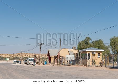 ASKHAM SOUTH AFRICA - JULY 6 2017: A street scene with buildings and vehicles in Askham a small town in the Northern Cape Province of South Africa