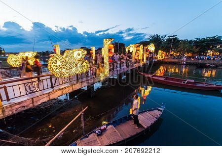 Hoi An, Vietnam - August 14, 2015: bridge over the Thu Bon river in the UNESCO World Heritage city of Hoi An.