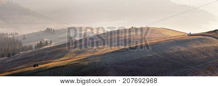 Ice, Frost On Colorful Autumn Meadow In Mountains. Sunny Autumn Sunrise Panorama.