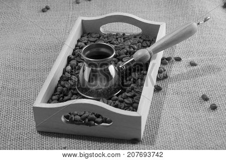 Greyscale horizontal front view of coffee box with brown coffee grains